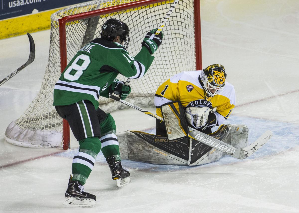 Colorado College goalie Alex Leclerc makes a save as North Dakota left wing Chris Wilkie looks for a rebound during the second period Saturday, Jan. 28, 2017, at the Broadmoor World Arena in Colorado Springs, Colo. Leclerc shut out the Fighting Hawks with 45 saves. (The Gazette, Christian Murdock)