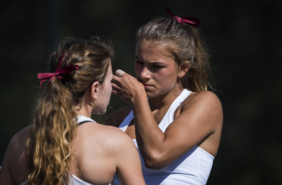 Cheyenne Mountain's Casey Ahrendsen, right, and Ally Arenson talks things over during  the No. 1 Doubles finals Saturday, May 13, 2017, at the 4A State Tennis Championships in Pueblo.  Ahrendsen and Arenson won their fourth straight No. 1 Doubles title with a 6-1, 6-2 win over Valor Christian's Tiffany Parobek and Lucie Hosse.  (The Gazette, Christian Murdock)