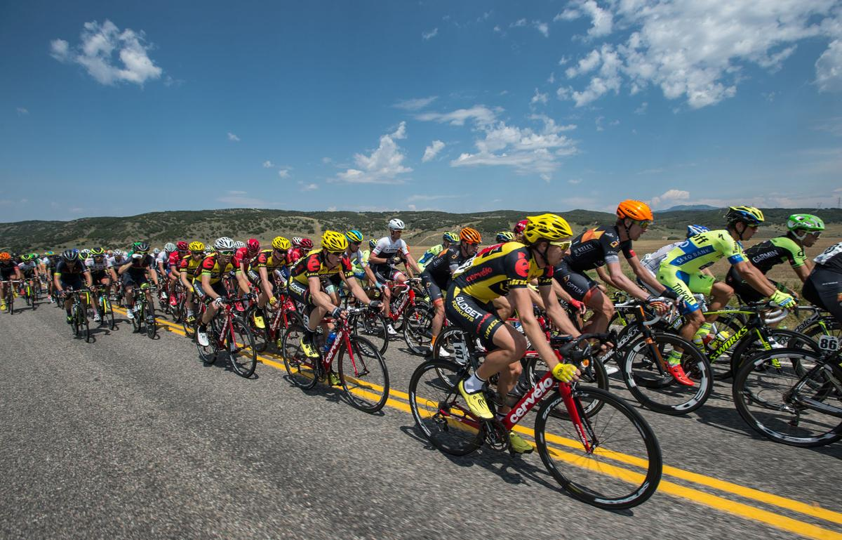 The peloton climbs a hill along Highway 33 toward Oak Creek Monday, Aug. 17, 2015, during Stage 1 of the 2015 USA Pro Challenge in Steamboat Springs, Colo. Stage 1 is a two-lap, 97 miles circuit beginning and ending in Steamboat Springs. (The Gazette, Christian Murdock)