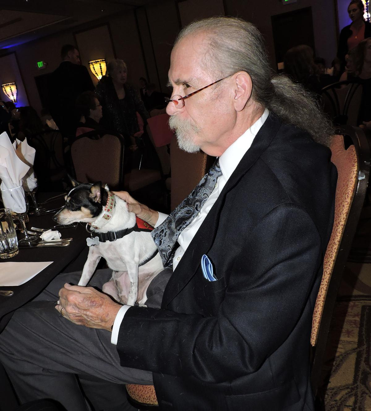 National Mill Dog Rescue benefit gala: Rich Strader and rescue dog Rosie listen to conversations at the gala. 101417 Photo by Linda Navarro