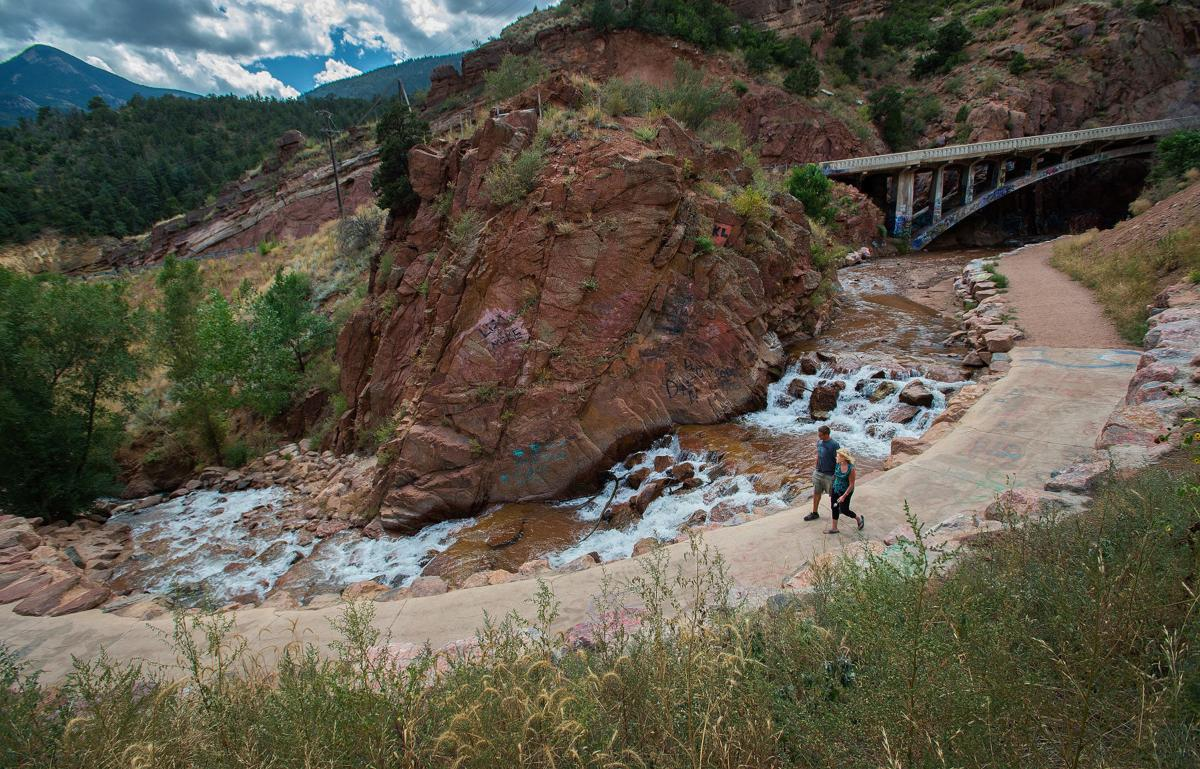 Dawn Hansen of Manitou Springs and Monte Hoover of Flagstaff, Ariz., walk along the new path to Rainbow Falls in Manitou Springs Tuesday, Sept. 7, 2015. The old trail was washed out in the flooding after the Waldo Canyon Fire. Hoover was visiting Hansen on his way to North Dakota. (The Gazette, Christian Murdock)