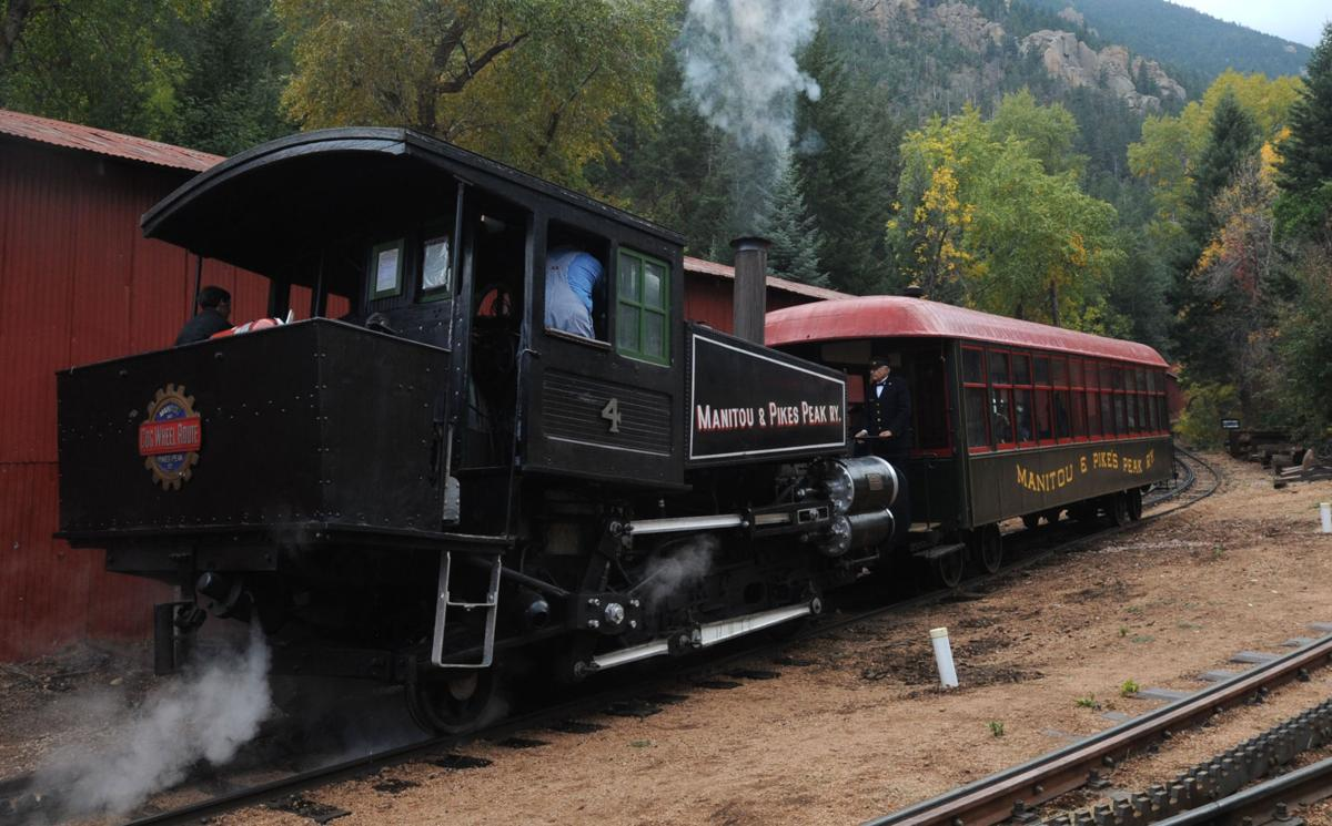 Steam Locomotive No. 4, built by the Baldwin Locomotive Works in 1897, pushes the 1890 Car 104 out of the Manitou and Pikes Peak Railway station Thursday, Sept. 27, 2012 testing it out. The railway hopes to run it once a month next summer. The Steam engine pushed cars to the summit of Pikes Peak until 1958. (The Gazette, Christian Murdock)