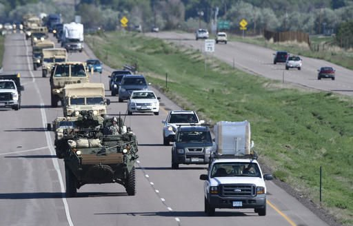 In this May 27, 2015 file photo, a Stryker armored vehicle leads a group of vehicles south on I-25 south in Colorado Springs, Colo. Investigators say an Army vehicle took the wrong road in the dark and was trying to make a U-turn when it tumbled 250 feet off a cliff at a Colorado training range in Feb. 2015, killing one soldier and injuring five. Investigators also said medical personnel had recommended that the soldier who died shouldnÂ't go on the exercise because of an unspecified condition. But it wasnÂ't clear if his condition was a factor in the 2015 crash of a Stryker fighting vehicle at Fort Carson. (Mark Reis, The Gazette)