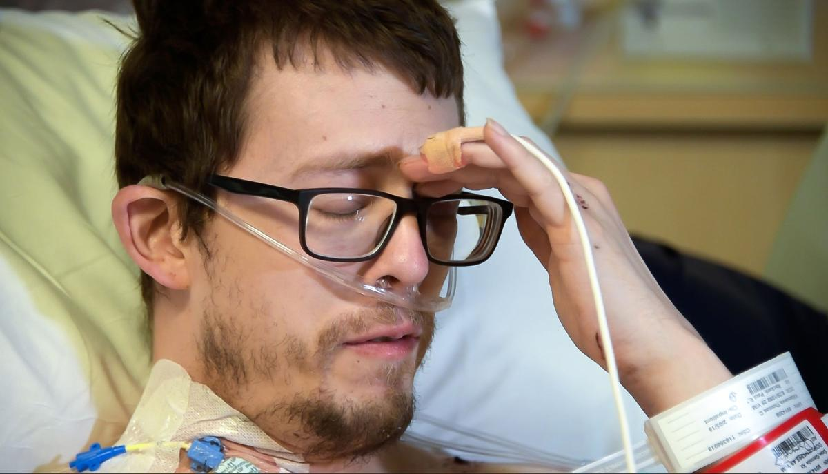 """Police shootout victim Thomas Villanueva fears he may be paralyzed from the waist down, but says he's """"glad to be alive."""" He talked about his ordeal at UCHealth Memorial Hospital Center on Thursday, February 8, 2018. Photo by Hannah Tran, The Gazette"""
