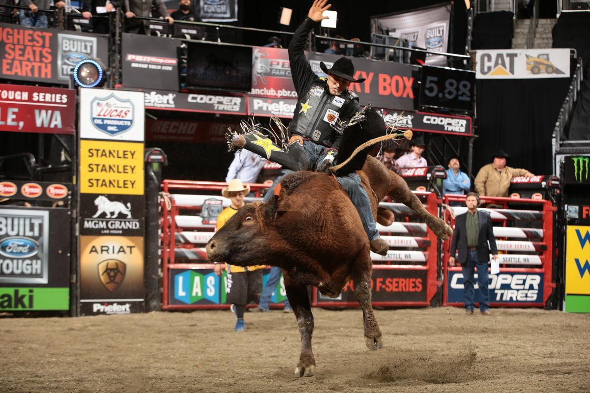 Joao Ricardo Vieira rides Dakota/Berger/Struve/Rosen's Cooper Tires Brown Sugar for 89.75 during the 15/15 Bucking Battle round of the Seattle Built Ford Tough Series PBR. Photo by Andy Watson.