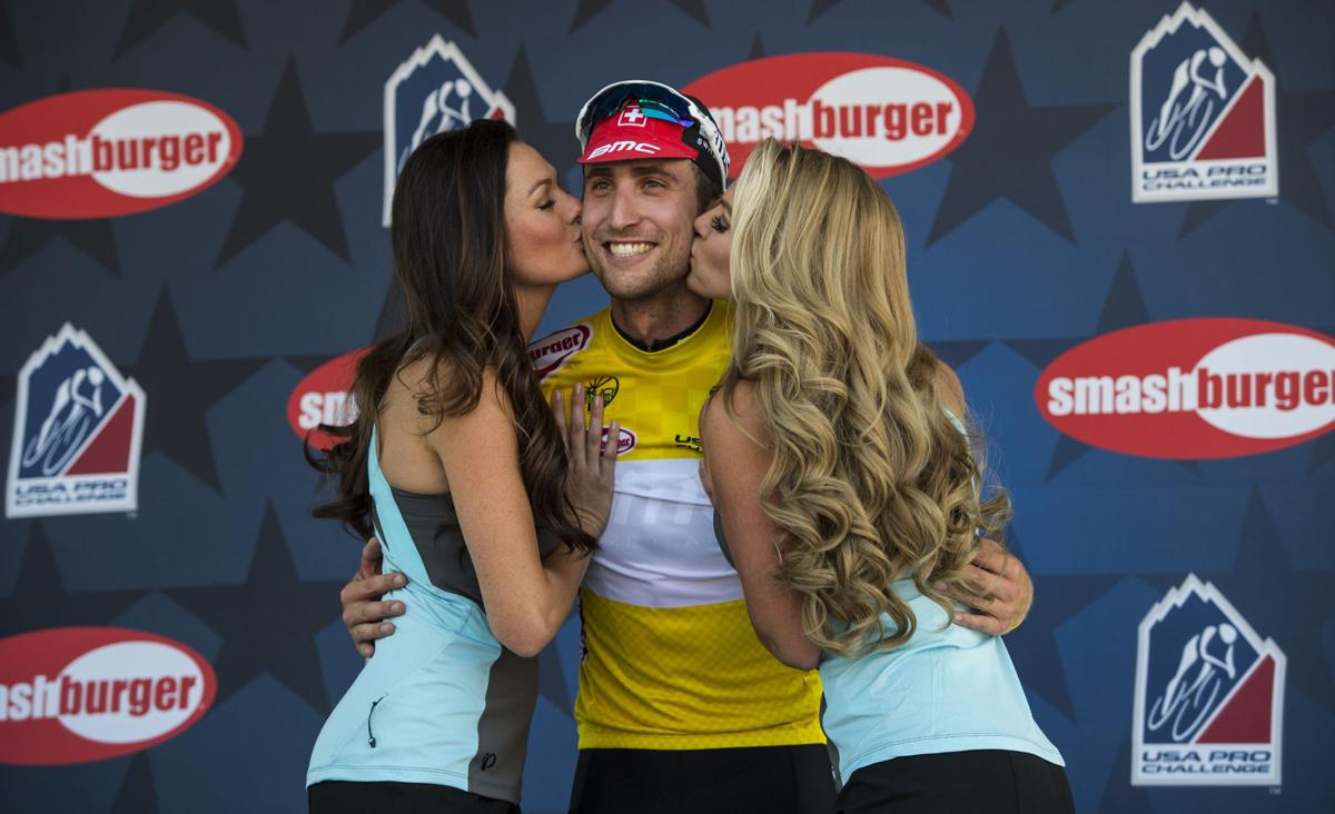 BMC Racing's Taylor Phinney of Boulder, Colo., earns the yellow jersey and a pair of kisses after winning Stage 1 Monday, Aug. 17, 2015, during the 2015 USA Pro Challenge in Steamboat Springs, Colo. Stage 1 is a two-lap, 97 miles circuit beginning and ending in Steamboat Springs. (The Gazette, Christian Murdock)