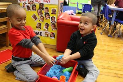 preschool-boys-playing-with-sand-900x0-c-default.jpg