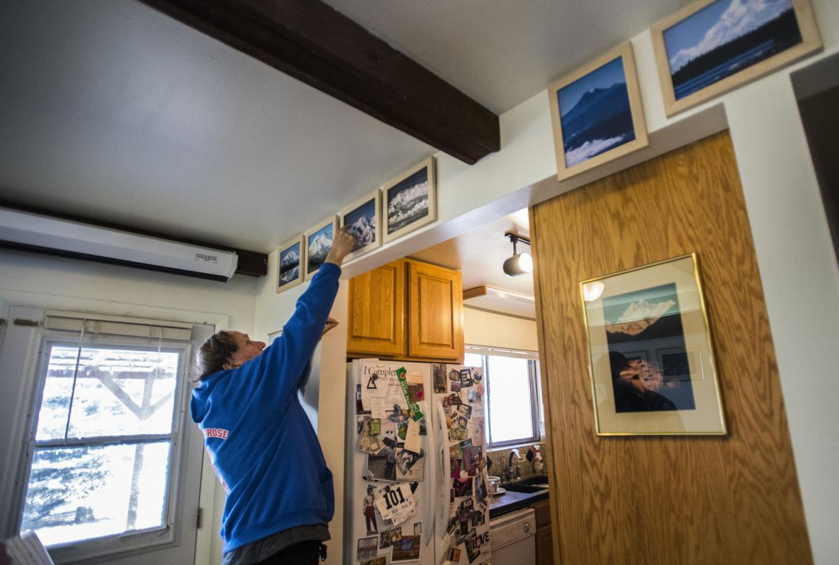 "World-class mountaineer and author Gerry Roach show pictures of some of the summits he's climbed around the world, Saturday, Jan. 13, 2018, at his Montrose home. Roach, 74, has summited the major mountains of the world include Mt. Everest and has written many books including the book that sits on a shelve of most climbers in Colorado - ""Colorado's Fourteeners: From hikes to Climbs."" (The Gazette, Christian Murdock)"