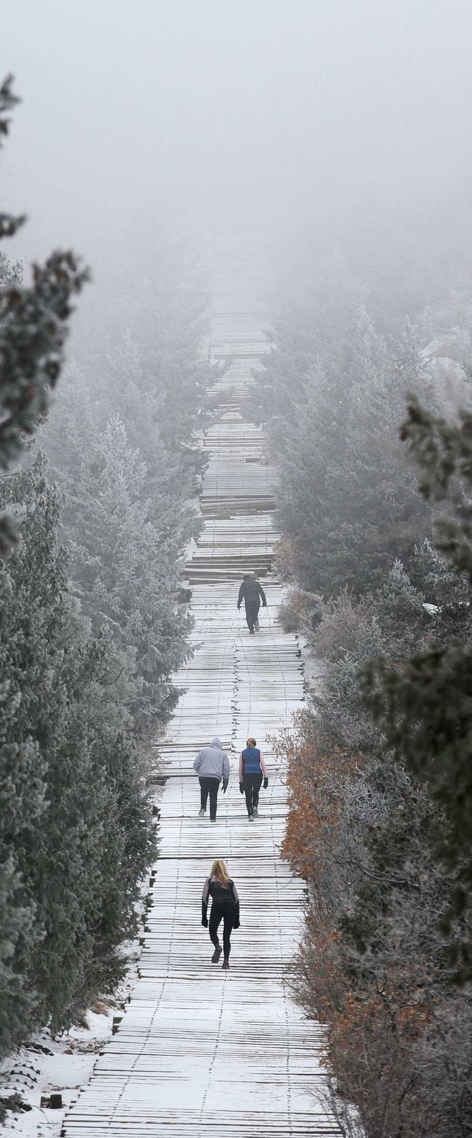 Hikers climb into the clouds while making their way up the Manitou Incline Friday, Feb. 25, 2011, in the snow. The light dusting of of snow made for a quiet, peaceful ascent. ( The Gazette, Christian Murdock)