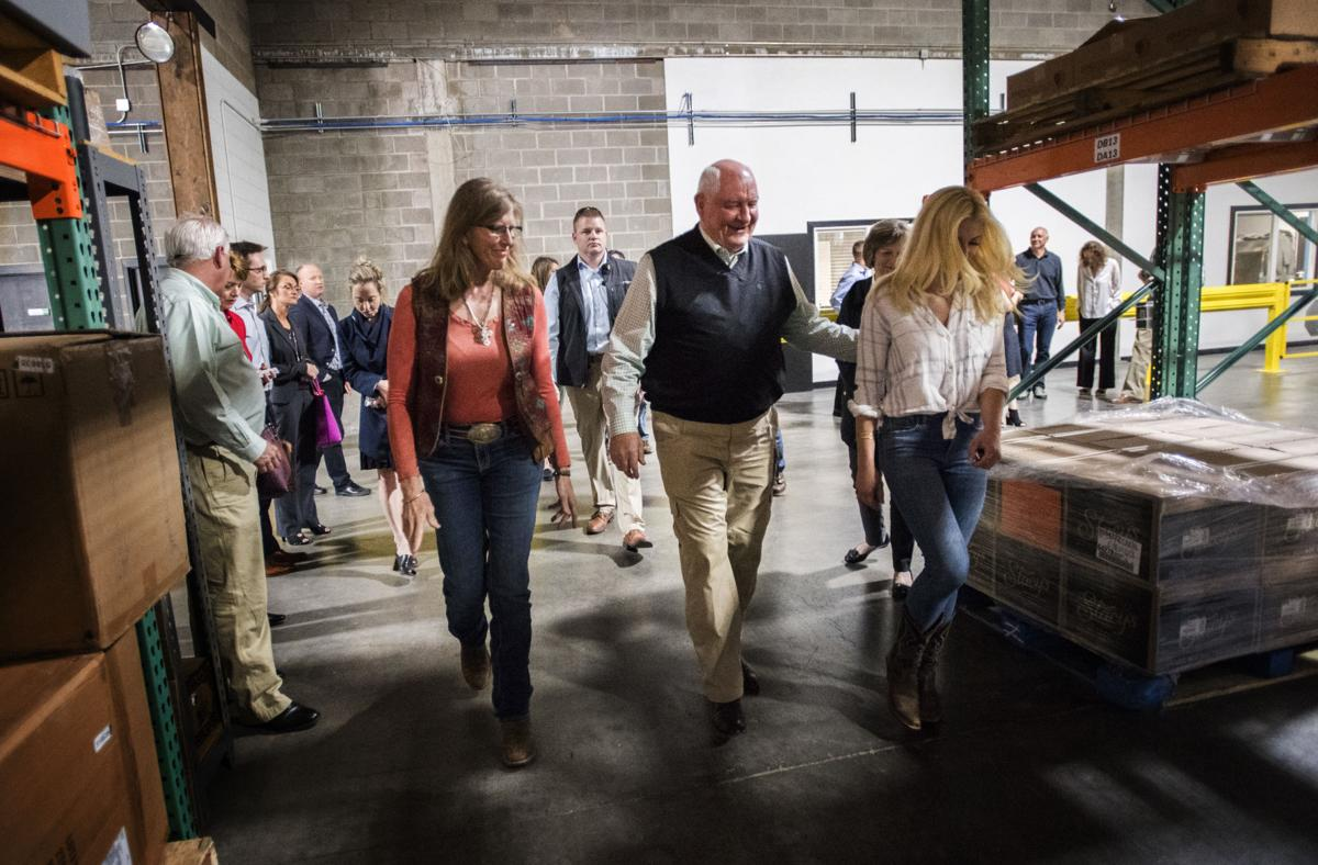 U.S. Secretary of Agriculture Sonny Perdue, center, visits with Westcliffe ranch owner Elvin Parker Ganschow, left, and Amber Strohauer of Strohauer Farms near Greeley, while touring the FoodMaven facility in Colorado Springs Tuesday, May 15, 2018. Perdue stopped at the Colorado Springs business while on a visit to New Mexico, Colorado, Wyoming and Nebraska. (The Gazette, Christian Murdock)