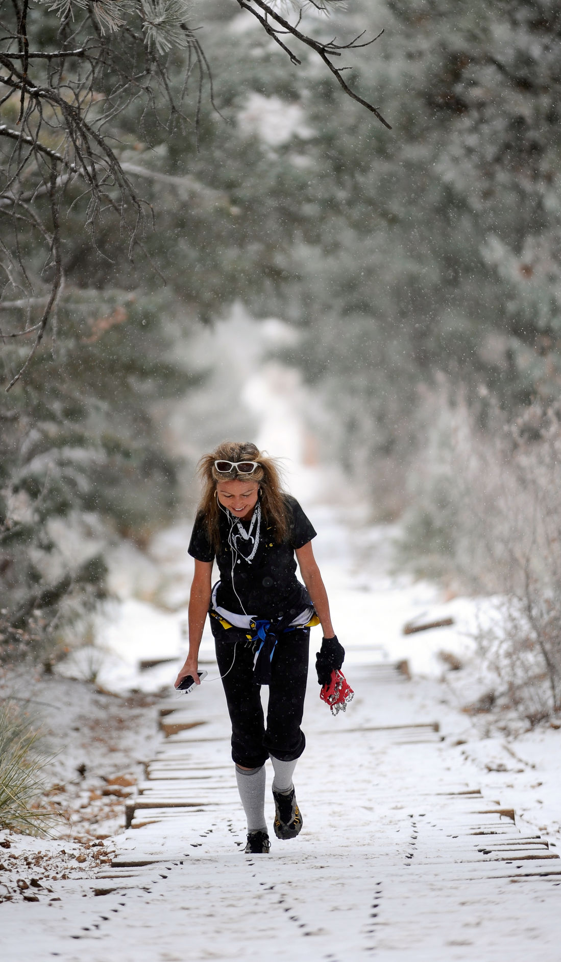 Jill Suarez hikes the Manitou Incline Friday, Feb. 25, 2011, in the snow. Suarez said she's been climbing the Incline since the railroad tracks were removed in the early 1990s and takes pictures, send texts and checks the internet while making the 2000-foot ascent. ( The Gazette, Christian Murdock)