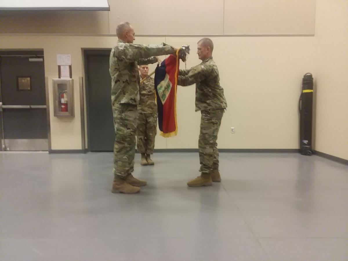 George and Holland fold flag