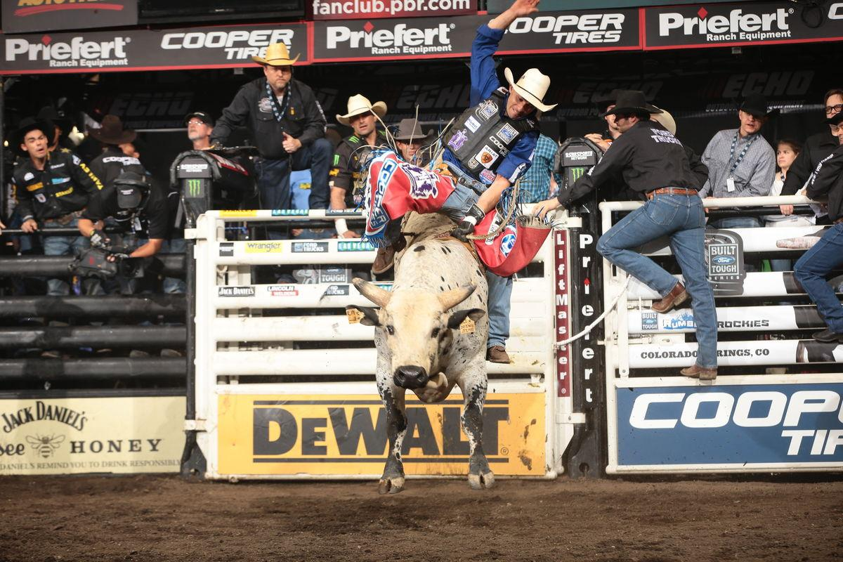 Renato Nunes rides Robinson's Doing Time for 85.25 during the third round of the Colorado Springs Built Ford Tough series PBR. Photo by Andy Watson