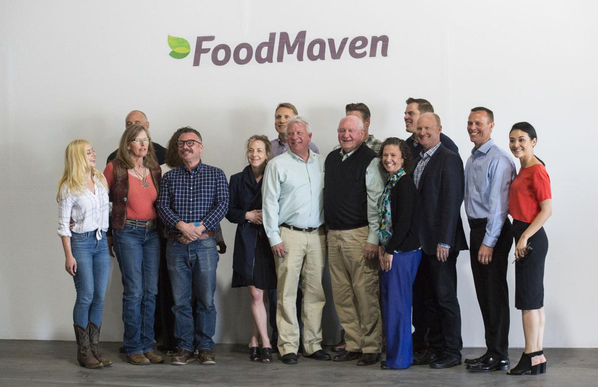 U.S. Secretary of Agriculture Sonny Perdue, center in vest, poses for a picture while touring the FoodMaven facility in Colorado Springs Tuesday, May 15, 2018. (The Gazette, Christian Murdock)