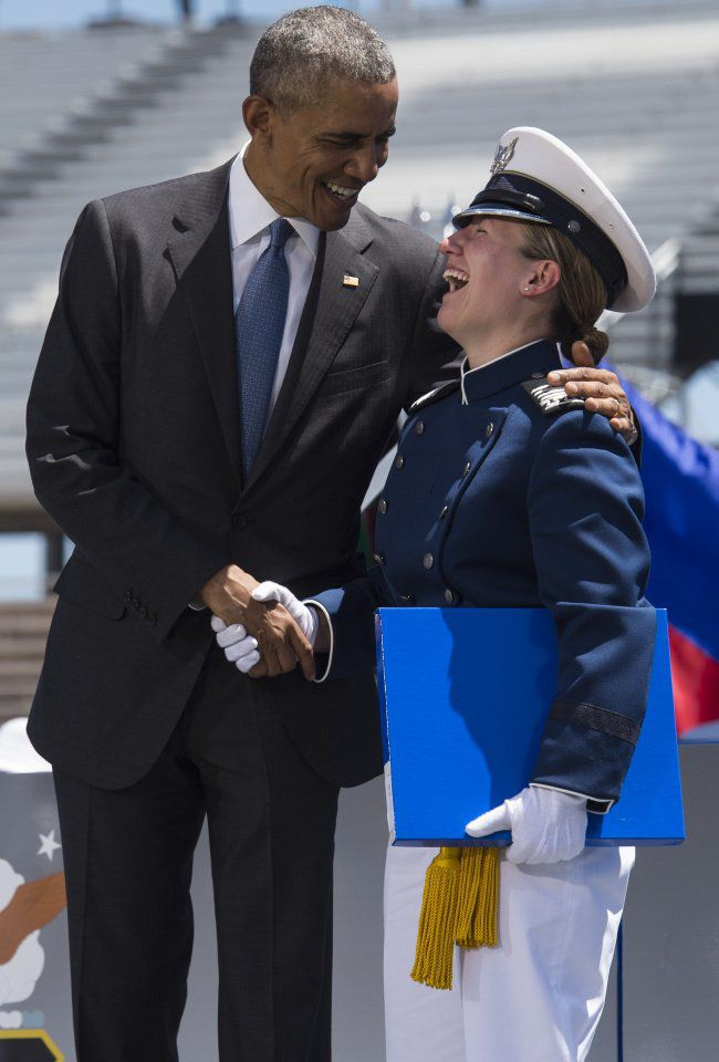 President Barack Obama jokes with a cadet Thursday, June 2, 2016, during the 2016 Commencement ceremony at Falcon Stadium on Air Force Academy. (The Gazette, Christian Murdock)