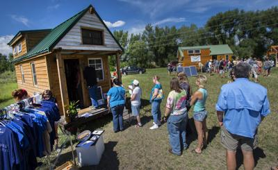 People wait in line to tour the TinyHouse Expedition home Saturday, Aug. 8, 2015, during the Tiny House Jamboree at the Western Museum of Mining and Industry in Colorado Springs. The owners, Alex Stephens and Christian Parsons, are traveling the United States for the next two years working on a documentary about tiny house communities. The jamboree continues Sunday. (The Gazette, Christian Murdock)