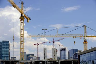 COVER STORY Building with Cranes Denver skyline