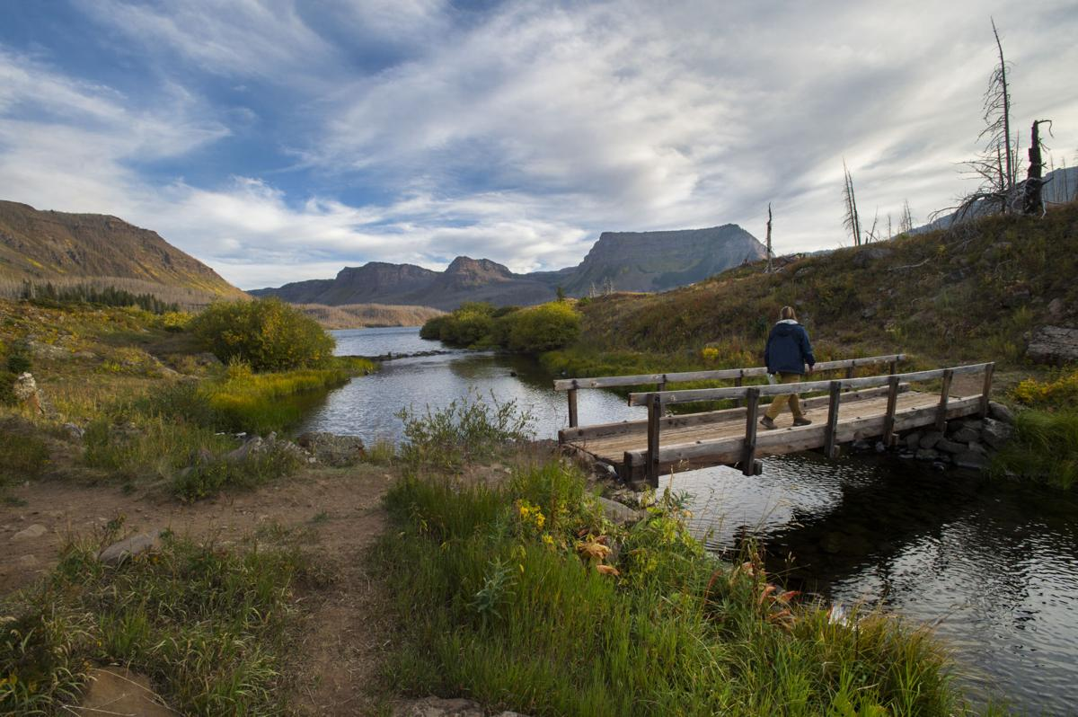 A hikers walks around Trappers Lake Wednesday, Sept. 7, 2016, in northwest Colorado. (The Gazette, Christian Murdock)