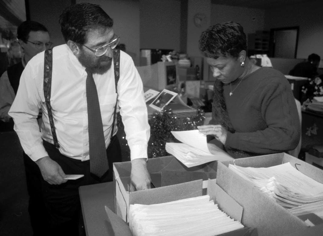 Lee Milner talks with City Clerk Kathryn Young after dropping off over 11,000 signatures on petitions for a trails and open space ballot initiative Monday, December 23, 1996. photo by Stuart Wong
