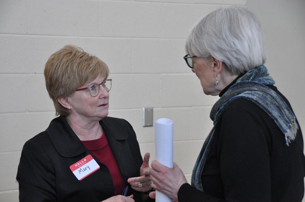 Mary Steiner shares drug overdose concerns with area resident Myrna Candreis