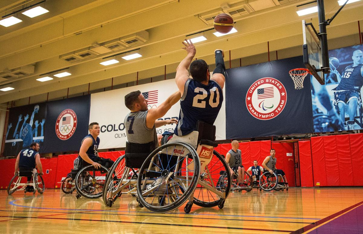 Jared Arambula (20) of Valparaiso, Ind., shoots over the defense of Ryan Neiswender of Lebanon, Pa., Tuesday, Jan. 5, 2016, during a selection camp for the 2016 Rio Paralympics at the Olympic Training Center in Colorado Springs. (The Gazette, Christian Murdock)