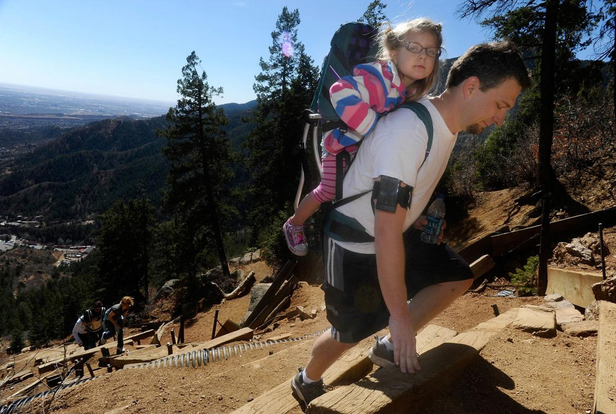 Bryan Burchett and his 4-year-old daughter, Gretchen, climb the Manitou Springs Incline Friday, April 8, 2011. Burchett's wife was out of town so he threw his daughter on his back to climb on the sunny spring day. ( The Gazette, Christian Murdock)