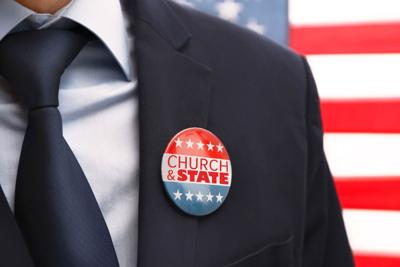 American votes concept. Man with badge on stars and stripes background