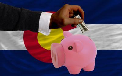 Colorado money dollars piggy bank revenue