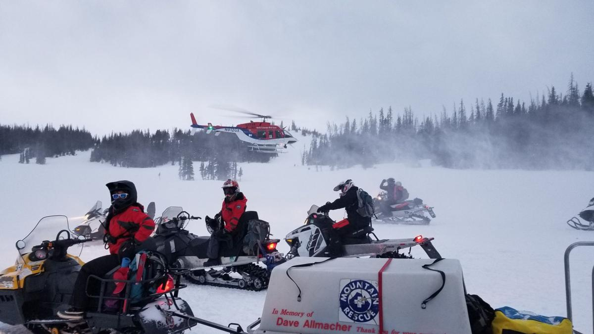 Woman drives snowmobile off 150-foot cliff in Colorado