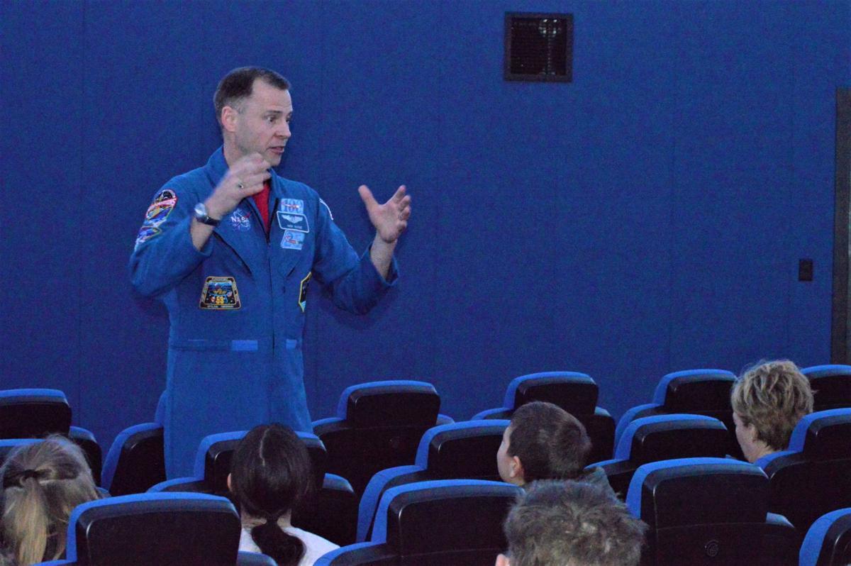Col. Hague addresses kids at planetarium.JPG