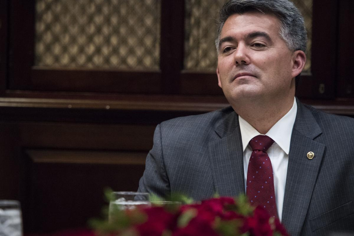 Sen. Cory Gardner, R-Colo., listens as President Donald Trump speaks before hosting a lunch with Senate Republicans in the Roosevelt Room of the White House in Washington on Dec. 5, 2017. MUST CREDIT: Washington Post photo by Jabin Botsford.