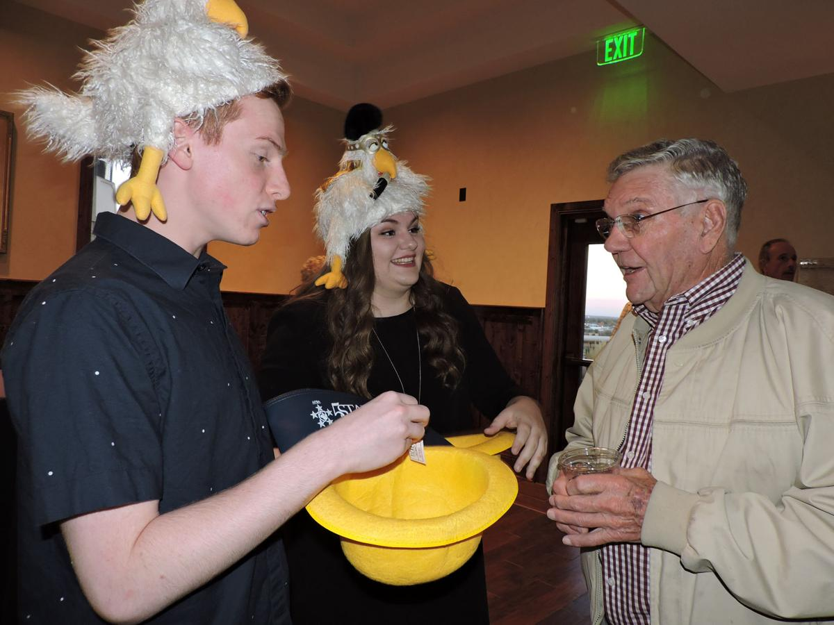 Scott Autry and Janae Hansen try their raffle drawing sales pitch on Russ Johnston at Koats 4 Kids. 102116 Photo by Linda Navarro