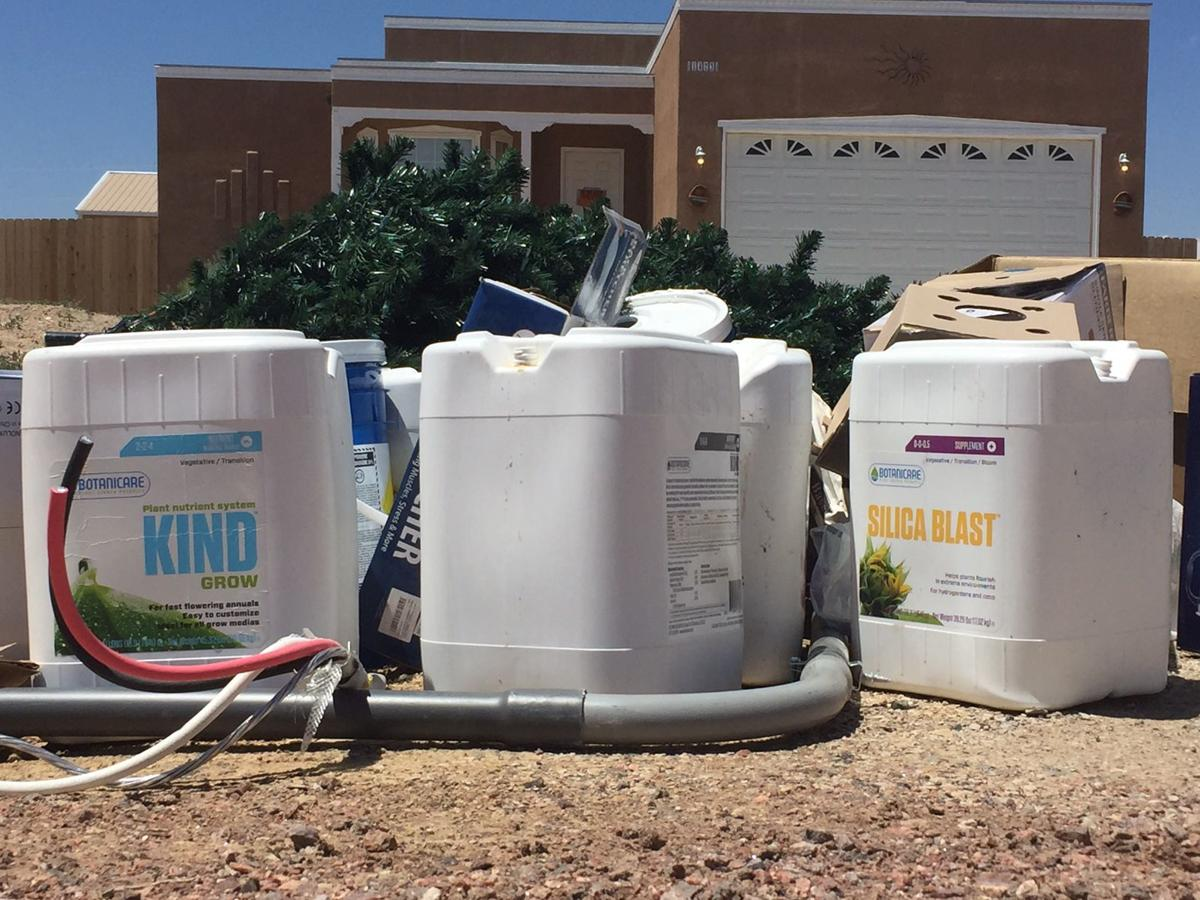 Chemicals and grow lights await trash pickup outside a Pueblo West home at 1473 N. Dailey Drive where the Pueblo County Sheriff's Office recently discovered an illegal marijuana grow. Photo by Kaitlin Durbin, The Gazette