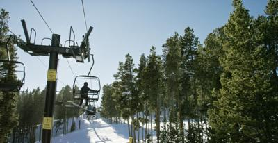 Snowboarders Ride a Ski Lift at Eldora Ski Resort near Boulder, Colorado on a Bright, Clear, Sunny Day (web copy)