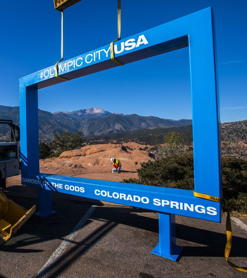 The controversial 12-foot blue box frames a worker from the Colorado Springs Park and Recreation department as he removes the bolts that held the frame in place at Garden of the Gods Park Monday, Dec. 18, 2017. The blue frame was installed Thursday as a marketing idea by the Olympic City USA task force and the locals quickly rejected it. As of Monday morning, more than 20,000 people had signed a petition started Friday. (The Gazette, Christian Murdock)