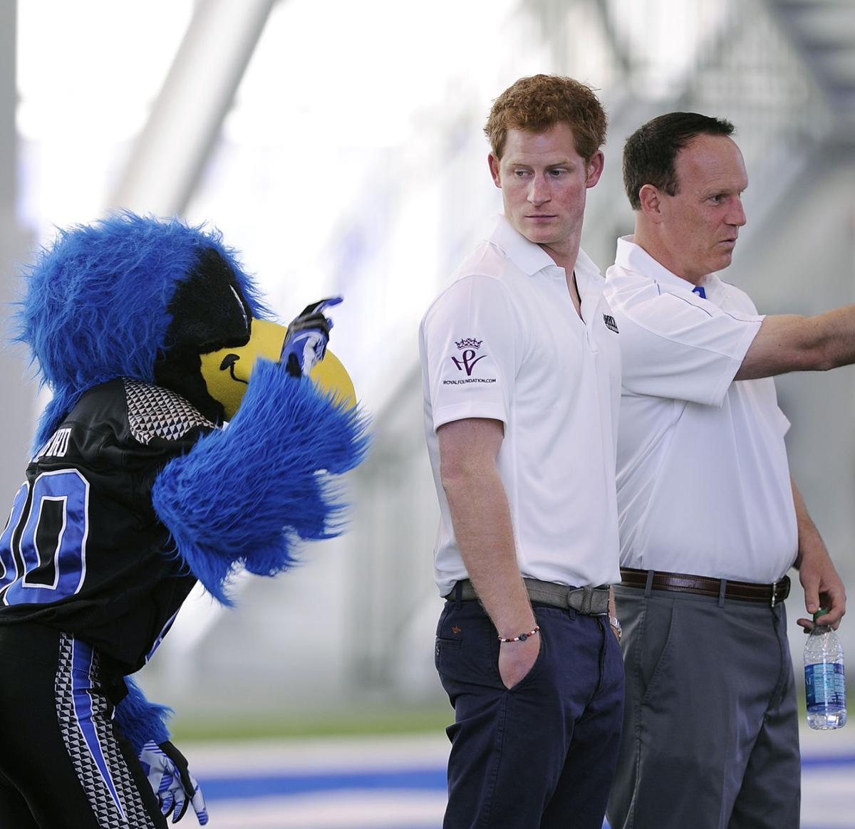 Prince Harry gets football tips from Air Force coach Troy Calhoun
