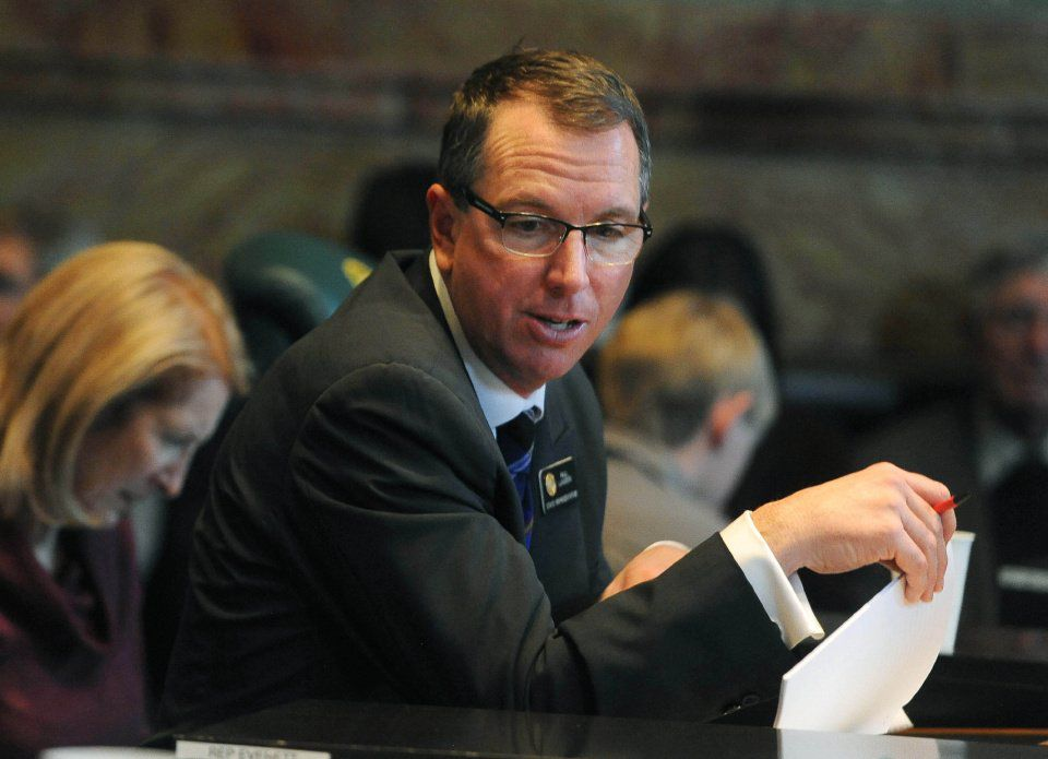 State Representative Paul Lundeen works on some paperwork during the first day of the Colorado General Assembly on Wednesday, January 7, 2015. Lundeen is a Republican from House District 19. (The Gazette/Jerilee Bennett)