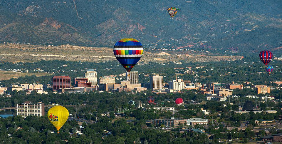 Balloons float over downtown Colorado Springs Sunday, Sept. 6, 2015, during the Colorado Springs Labor Day Lift Off in Memorial Park. (The Gazette, Christian Murdock)