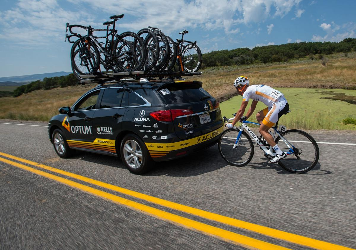 Benjamin Dilley of Team Novo Nordisk drafts behind a team car Monday, Aug. 17, 2015, during Stage 1 of the 2015 USA Pro Challenge in Steamboat Springs, Colo. Stage 1 is a two-lap, 97 miles circuit beginning and ending in Steamboat Springs. (The Gazette, Christian Murdock)
