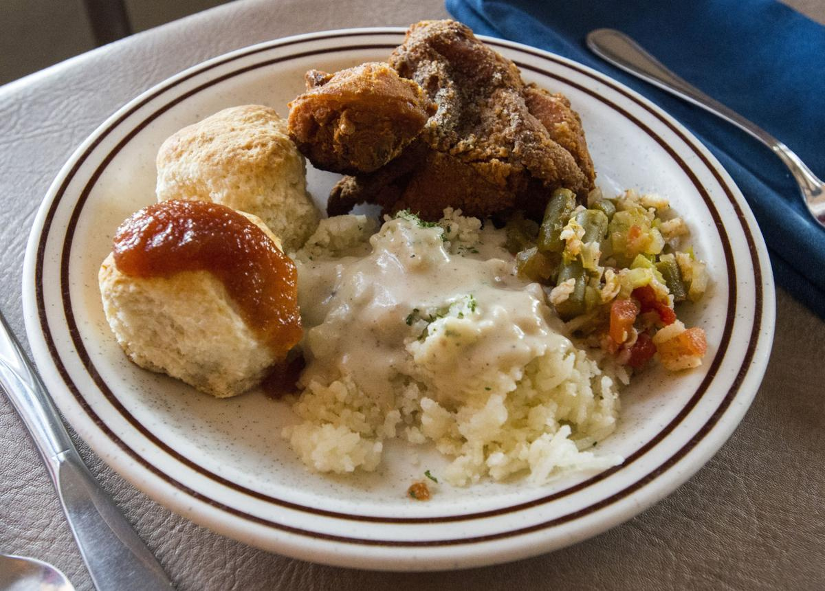 A serving of skillet-fried chicken, riced potatoes and cream gravy, okra casserole and homemade biscuits with apple butter Friday, April 7, 2017, at the Juniper Valley Ranch, 15 miles south of Colorado Springs. The family restaurant has been serving the same home-style meals since 1951. (The Gazette, Christian Murdock)