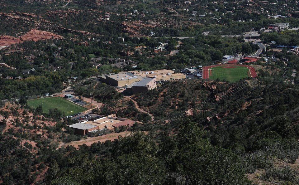 Manitou Springs Middle School, left, and Manitou Springs High School as seen from the top of Iron Mountain Tuesday, Oct. 1, 2013. (The Gazette, Christian Murdock)