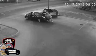 Surveillanve video of suitcase being thrown in dumpster