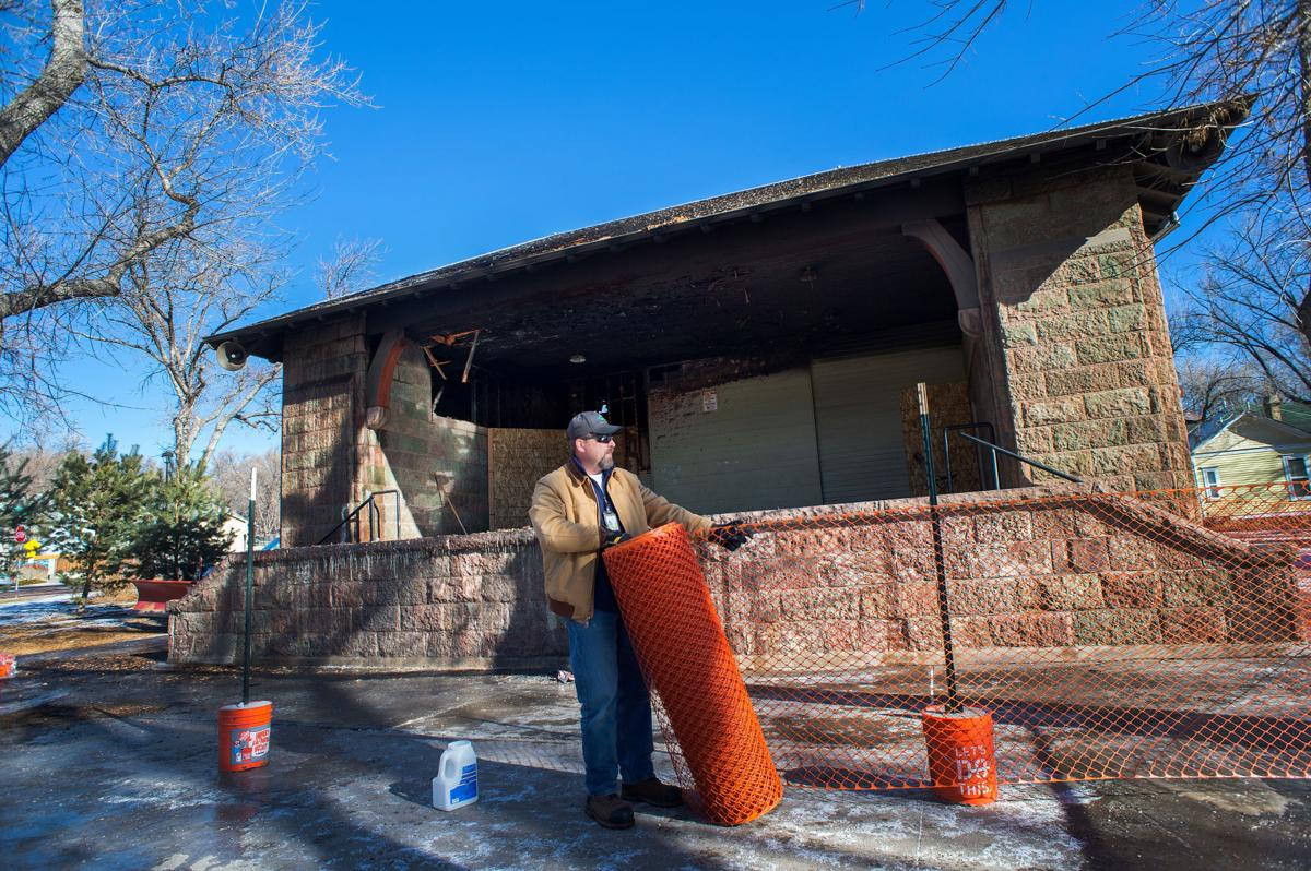 Colorado Springs employee Jeff Dickson strings a baracade around the band shell in Bancroft Park after a early morning fire damaged the historic structure Friday, Jan. 27, 2017. (The Gazette, Christian Murdock)