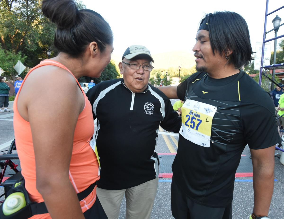 About 800 runners take off in the Pikes Peak Marathon on Sunday, August 17, 2014. (The Gazette/Jerilee Bennett)