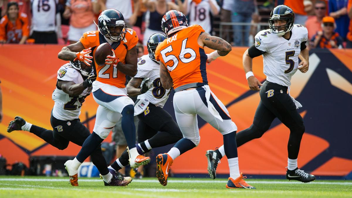 Broncos cornerback Aqib Talib intecepts a pass by Ravens quarterback Joe Flacco and returns its 51 yards for a touchdown during the third quarter Sunday, Sept. 13, 2015, at Sports Authority Field at Mile High in Denver. (The Gazette, Christian Murdock)