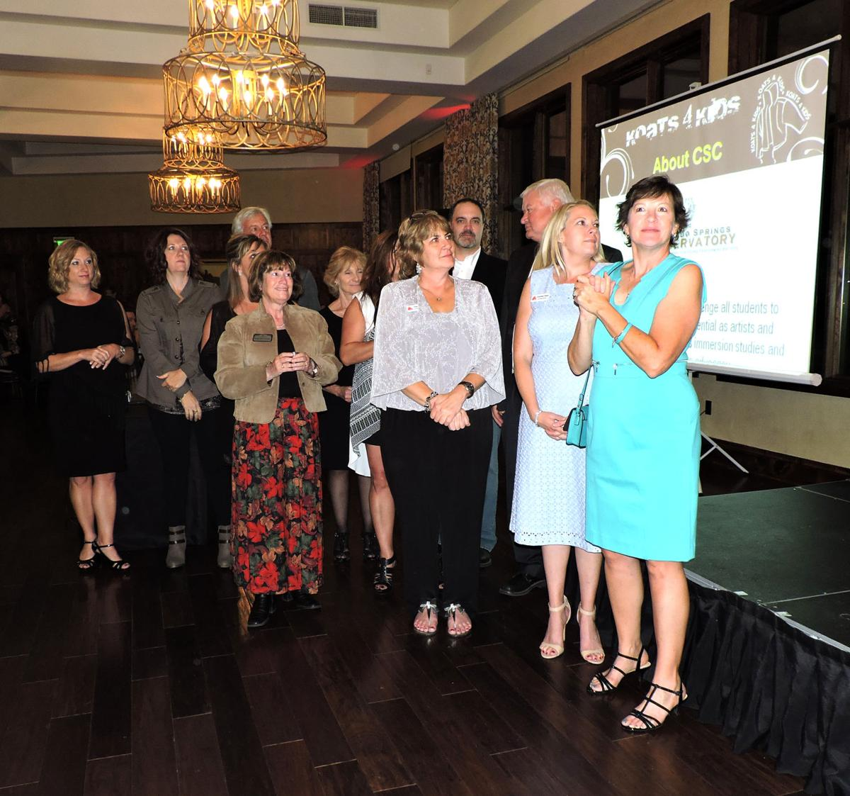 There were cheers for the 10th anniversary Koats 4 Kids committee members. 102116 Photo by Linda Navarro