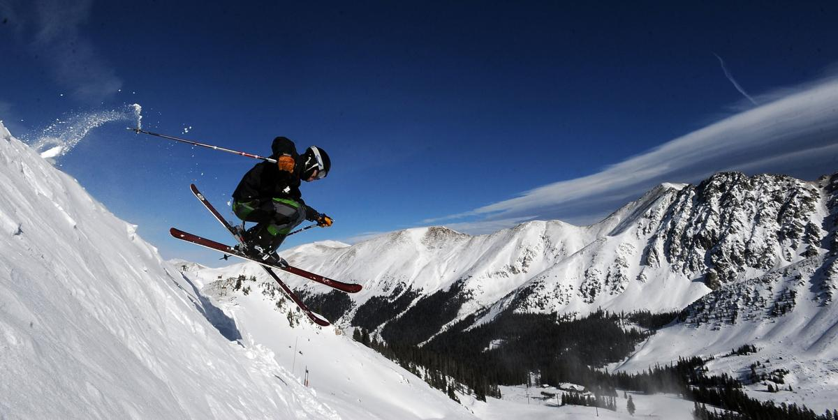 Adam Christopher of Denver jumps the cornice into Nose run on a sunny, cold day at Arapahoe Basin Tuesday, Nov. 30, 2010. (The Gazette, Christian Murdock)