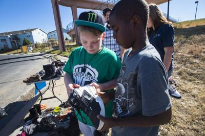 Colorado Springs boy stabbed in school answers bullying with shoe giveaway