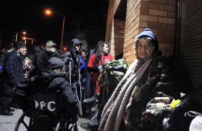 M.J. Tee, right, waits outside of the Salvation Army homeless shelter on 505 S. Weber St. for it to open for the night Friday February 5, 2016. Tee who is from New Mexico has been homeless since October. CAROL LAWRENCE, THE GAZETTE