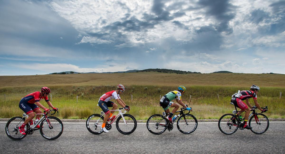 Riders Carson Miller, front, of Jamis-Hagens Berman p/b Sutters Homes, Emerson Oronte of Team Smartstop, Guillaume Boivin of Optum p/b Kelley Benefit Strategies and Jordan Kerby of Drapac Pro Cycling race along Highway 33 toward Oak Creek Monday, Aug. 17, 2015, during Stage 1 of the 2015 USA Pro Challenge in Steamboat Springs, Colo. Stage 1 is a two-lap, 97 miles circuit beginning and ending in Steamboat Springs. (The Gazette, Christian Murdock)
